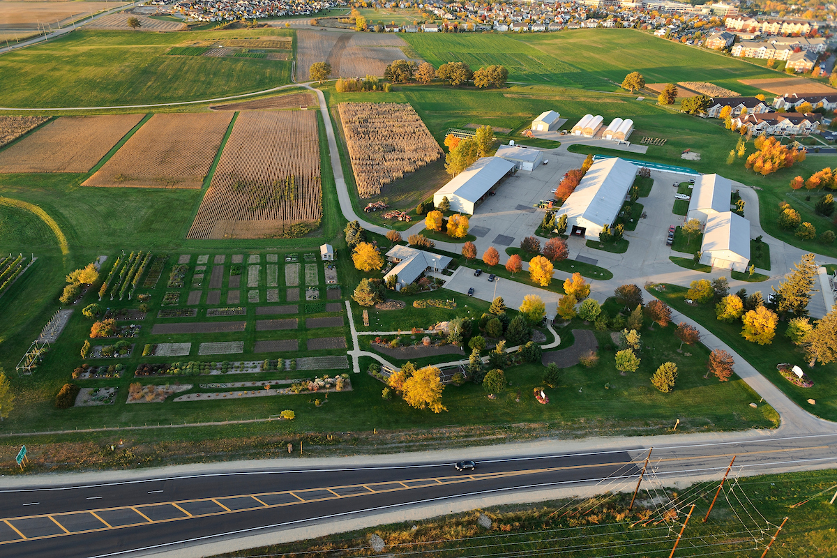 The West Madison Agricultural Research Station is pictured in an aerial view of the University of Wisconsin-Madison campus during an autumn sunset. Photo by Jeff Miller/UW-Madison.